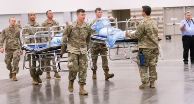 Texas Army National Guard troops set up a field hospital in response to COVID-19 April 1, 2020, at the Kay Bailey Hutchison Convention Center in Dallas, Texas. Service members across Texas worked to set up Geographically Separated Units (GSU) to support local communities. (Texas Air National Guard Photo by A1C Charissa A. Menken)