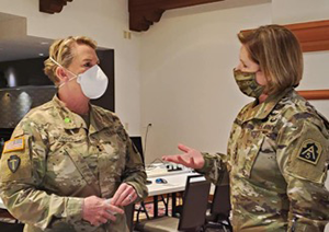 Maj. Gen. Tracy Norris, the Adjutant General of Texas (left), converses with U.S. Army North Commanding General, Lt. Gen. Laura Richardson (right), during a visit to the Texas State Operations Center in Austin, Texas, July 16, 2020. While there, military and civilian leaders strengthened their partnership and discussed the joint military COVID-19 operation in support of federal efforts and the state. U.S. Northern Command, through U.S. Army North, remains committed to providing flexible Department of Defense support to states in need as well as the Federal Emergency Management Agency in support of the whole-of-nation COVID-19 response. (U.S. Army photo by Col. Martin O'Donnell / U.S Army North Public Affairs)
