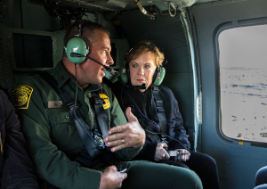 EL PASO, Texas -- U.S. Border Patrol Agent in Charge Walter Slosar gives a guided aerial tour of the U.S. border to Rep. Kay Granger, the congresswoman from Texas District 12 and ranking member of the House Appropriations Committee, and the Adjutant General of Texas, Maj. Gen. Tracy Norris, during her congressional visit to the area, Nov. 22, 2019. The delegation traveled by a Texas Army National Guard UH-60 Black Hawk from El Paso through Monuments I and III to the U.S. Border Patrol's Santa Teresa Station in Sunland Park, New Mexico. At the station, Rep. Granger, Maj. Gen. Norris, U.S. Army Budget Liaison Maj. Mark Bedrin, House Appropriations Committee Professional Staff Homeland Minority Clerk Dena Baron and Communications Director Sarah Flaim, met with CBP personnel and U.S. Army Corps of Engineers representatives to further discuss the state of the border, specifically in their sector. (U.S. Army National Guard photo by Spc. Christina Clardy)
