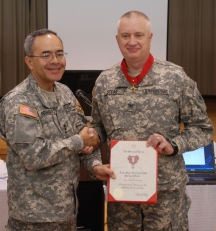 Lt. Gen. Charles Rodriguez, the Adjutant General of Texas presented Texas State Guard (TXSG) Colonel Frank Stead, Medical Brigade, with the Texas State Distinguished Service Medal in Brownsville, Texas, for his outstanding performance during the last year's Operation Lone Star 07 (OLS). Photo by CPT . Michael Spraggins PAO TXSG