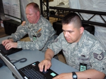 Sgt. Marc Jones (left) of the Texas Army National Guard's Standing Joint Interagency Task Force (SJIATF) and Staff Sgt. Gonzalo Roman of Texas Air National Guard 149th Fighter Wing at San Antonio Emergency Operation Center as Hurricane Dolly moves westward towards south Texas Aug. 23. The Category 2 hurricane that is the first of the 2008 Atlantic Hurricane season severely damaged the coastal cities Brownsville and South Padre Island with strong winds and heavy flooding. (Texas Military Forces by First Sgt. Lek Mateo, 100th Mobile Public Affairs Detachment)