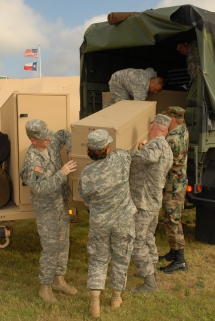 Members of the Texas Army and Air National Guard and Texas State Guard unload supplies to prepare for rescue and relief efforts in response to Hurricane Dolly next to the Emergency Operations Center at Brooks City-Base in San Antonio, Texas July 23. Photo by Air Force Tech. Sgt. Elisabeth A. Matulewicz
