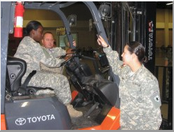 TXSG personnel engaged in forklift operations supporting recovery from the effects of Hurricane Dolly in Welasco, Texas.Photo by CPT Michael Spaggins, JMTF Public Affairs Officer