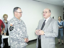 Brownwood Mayor Bert Massey, right, welcomes Maj. Gen. Christopher J. Powers, commanding general of the Texas State Guard, to Brownwood Friday during a reception at Adams Street Community Center. More than 200 members of the Texas State Guard will be training at Camp Bowie over the next two weeks. Photo by Gene Deason
