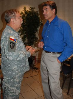 Governor Rick Perry discusses TXSG operations with BG Victor M. Ortiz Jr. during recent hurricane activation.Photo by MAJ Michael Spraggins