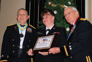 Major General Jose S. Mayorga (left) Adjutant General of Texas and Major General Raymond C. Peters (right) Texas State Guard Commanding award PO1 Michelle Gish TXSG Maritime Regiment two awards; 2009 Junior Enlisted of the Year, and the Texas Medal of Merit for lifesaving actions while on TXSG hurricane shelter duty during Hurricane IKE.