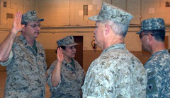 (L-R) SCPO Westberry, PO1 Lee, being sworn into the TMAR by CDR Cave, BGen BodischPhoto by WO1 George Monnat TMAR TXSG TMF