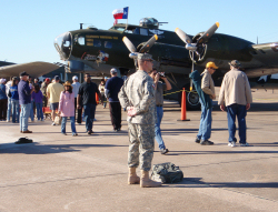 "A 8th Regiment, Texas State Guard, Soldier provides flight line crowd control in front of Commemorative Air Force Boeing B-17G Flying Fortress ""TEXAS RAIDERS"".Photo by 1LT Joseph Conte, 8th Regiment Public Affairs, Texas State Guard"