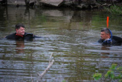 Sgt. Corey Lewis, of Plano, and Petty Officer Carl Clary, of Madisonville, conduct a side-by-side search of Lake Houston waters in an effort to recover aircraft debris during a training exercise April 10. Both are members of the Texas State Guard Maritime Regiment (TMAR) 1st Battalion Rescue Dive Team.