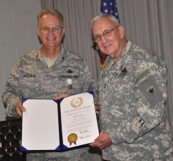 Photo of Major General Raymond Peters presenting the Commander's Award for Public Service to retiring Brigadier General Robert Cheeseman.