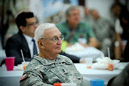 Photo of Maj. Gen. Raymond Peters listening to Maj. Gen. John Nichols.