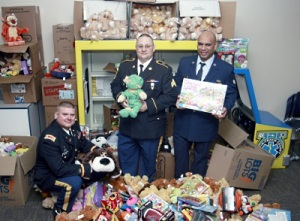 (L to R) MAJ Christopher Sauceda, SGT Johnny Gately, and SrA Rheuben Towne present some 1,300 toys to the Dell Children's Hospital on behalf of the soliders of the TXSG.