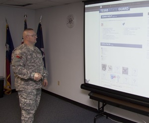 Photo of SGT Gately presenting the new website