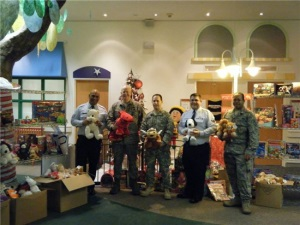Group Photo with a large amount of toys in boxes