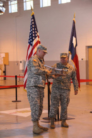MAJ Britton presents LTC Krueger with the Cavalry Saber from the 2nd Bn. Photographed by SPC Hays, 2nd Bn., 8th Regt. 16 AUG 2014