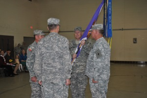 Photo: (Credit-SSG Malana Nall) LTC Buddy Grantham holds the regimental colors after accepting command of the 8th Regiment from Brigadier General Jake Betty