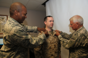 "Members of the Del Rio JOIC stood in formation as Col Hamilton and Maj Kali Pinckney, Commander of the 449th ASG, pinned on his new rank.   Col Hamilton explained, ""I'm pleased to promote CPO Gilbert to SCPO.  Chief Gilbert began his TXSG career with the Army side, later when TMAR stood up, he transferred to that component."""
