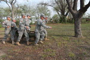 The 4th Regiment team carries a 200-pound dummy during the wounded casualty extraction challenge.