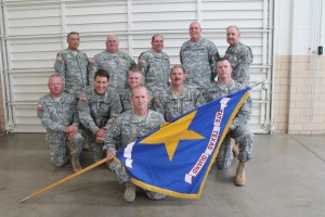 Photo of 4th Regiment Gonzales Cup Team with 4th Regiment Support Personnel (first row left to right) SSG Gary Harvel, CPL Justin Carter, SPC Stephen Walton, SSG Dennis Burks (in front), CPL Joe Ringnald, PFC David Anderson; (second row left to right) CSM Albert Willars, SFC Richard Shillling, WO Ray Spoth, COL Howard Palmer, Jr., and LTC Lloyd Lietz.
