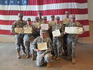 Warrior Leadership Course Graduates on April 27, 2014 (left to right) PFC Anthony Rose, PFC Lynda Briggs, CPL Bailey Phillips, CPL Hans Hansen, PFC Sylvia Maza, PFC Adrian Washburn (kneeling), SGT Gayle Linke, PFC Tessa Smith, PFC Erick Schluter, and SPC Colin O'Brien. Photo by CW2 Janet Schmelzer, 4th Regiment PAO.