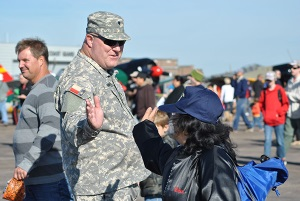 Photo Credit to: SSG Malana Nall, PAO - 8th REGT   - SPC Mark Renfro receives a high five from a visitor to the 30th Annual Wings Over Houston Air Show.