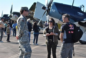 Photo Credit to: SSG Malana Nall, PAO - 8th REGT - PV2 Nicholas Ognanovich talks with visitors while keeping them safe from moving aircraft on the flight line of the 30th Annual Wings Over Houston Air Show.