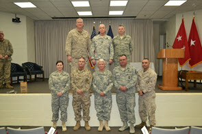 Members of the TXSG OCS Command Staff and Instructor Cadre. Photo Credit: Capt. Shawn James. Top Row (left to right): LT Keith Przybyla, CPT H. Lee Burton, Capt. Christopher Click Bottom Row (left to right): CPT JoAnna Carle, MGySgt(MC) Nichols, COL Thomas Hamilton, MSgt Raymond Winkler, Sgt Patrick Rodriguez