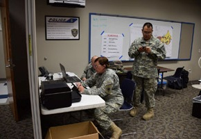 Staff Sgt. William Wiley, Staff Sgt. Brenda Newton, and Spc. Desmon Dunn from the 39th Composite Regiment, Texas State Guard provide administrative support to the Disaster District Coordinators from the Texas Department of Emergency Management during the flood emergency operations in Wichita Falls, Texas, May 23, 2015.  The assistance of the soldiers to the emergency contributed to the ability first responders to rescue, evacuate, and provide emergency services to local residents.  (Texas State Guard photo by 39th Regiment/ Released)