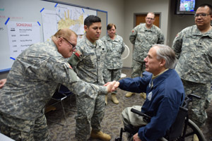 Texas Governor Greg Abbott shakes hands with Staff Sgt. William Willey, and thanks Capt. Michael Garcia, Staff Sgt. Brenda Newton, Spc. Zach Willams, and Spc. Desmon Dunn from the 39th Composite Regiment for their service during flood emergency in Wichita Falls, Texas, May 25, 2015.  (Texas State Guard photo by 39th Regiment/Released)