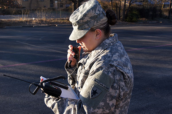 Pfc. Kristin Galaviz, 2nd Regiment, Texas State Guard, practices radio communication during a points of distribution exercise at the First Presbyterian Church in Stephenville, Texas, January 23, 2016.  Providing food and water distribution points is a skill that the Texas State Guard can provide to assist local residents during an emergency. (Photo by Spc. Stefan Wray, 2nd Regiment/Released)