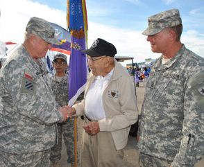 "Col. Edwin Grantham, Commander, and Command Sgt. Maj. John Marshall, Senior Enlisted Advisor, 8th Regiment, Texas State Guard, present a regimental challenge coin to World War II veteran Col. Richard ""Dick"" Cole, during a ceremony at the 32nd Annual Wings over Houston Air Show at Ellington Field Joint Reserve Base, Houston, Oct. 22-23, 2016.   Cole is the last surviving member of the Doolittle Tokyo Raiders and was co-pilot to Gen. Doolittle during the famous raid on Tokyo during World War II.  (Texas State Guard photo by Warrant Officer Malana Nall)"