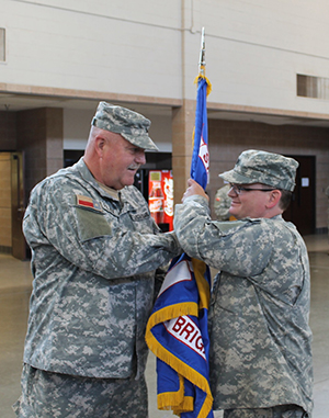 Lt. Col. Jeremy Franklin, incoming commander of the 39th Composite Regiment, Texas State Guard. Brig. Gen. Howard N. Palmer, Jr., Commander, Army Component Command, Texas State Guard, hands the regimental guidon to Franklin in a change of command ceremony in Lubbock, Texas, April 23, 2016.  Franklin had previously served as the Executive Officer and Chief Medical Officer of the 39th. (Texas State Guard photo by Chief Warrant Officer 2 Janet Schmelzer).