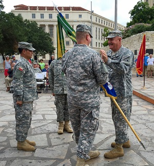 Col. Kris Krueger became the new commander of the 1st Regiment, Texas State Guard, in a change of command ceremony in front of the Alamo, in San Antonio, Texas, July 16, 2016.  Brig. Gen. Howard N. Palmer, Jr., Commander, Army Component Commander, Texas State Guard, presented the guidon of the 1st Regiment to Krueger.  The guidon or colors of the unit symbolizes the transfer of authority and responsibility to a new commander.   (Photo by Staff Sgt. Juan Trevino, Texas State Guard)