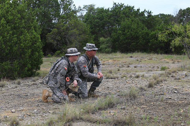 SFC Thomas Adamowicz and SGT Mark Lydahl conduct a leader's reconnaissance prior to deployment of the GSAR team into the search area.