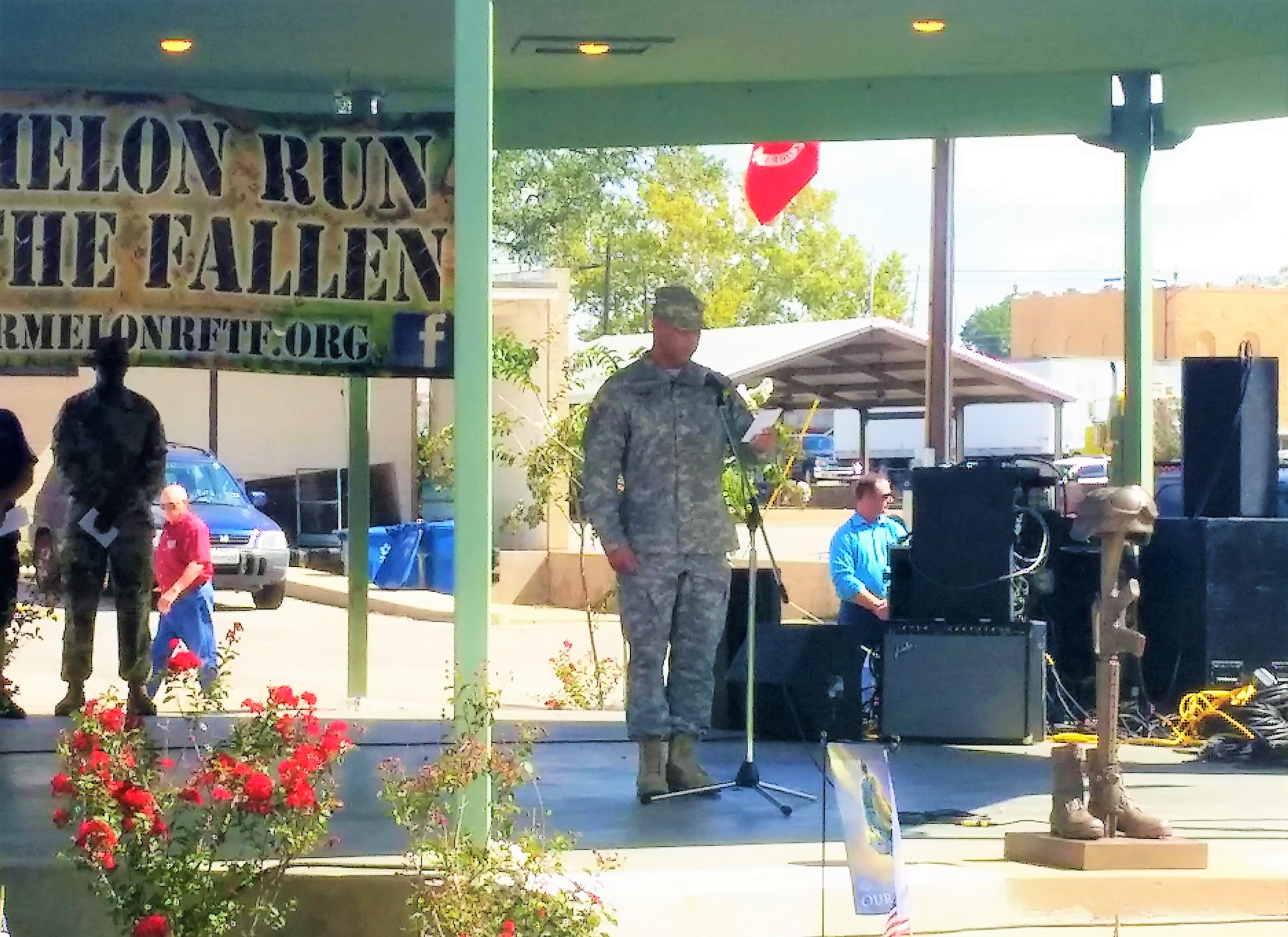 Sgt. Eseil Hernandez, 8th Regiment, Texas State Guard, reads names of fallen Texas service members during the annual Watermelon Run for the Fallen remembrance ceremony held at the Staff Sgt. Jeffery Lee Hartley Memorial Park, in Hempstead, Texas, August 19, 2017. This event honors Texas service members who have died in the service of Texas and the country since September 11, 2001. (Texas State Guard photo by Staff Sgt. Gregory Illich)