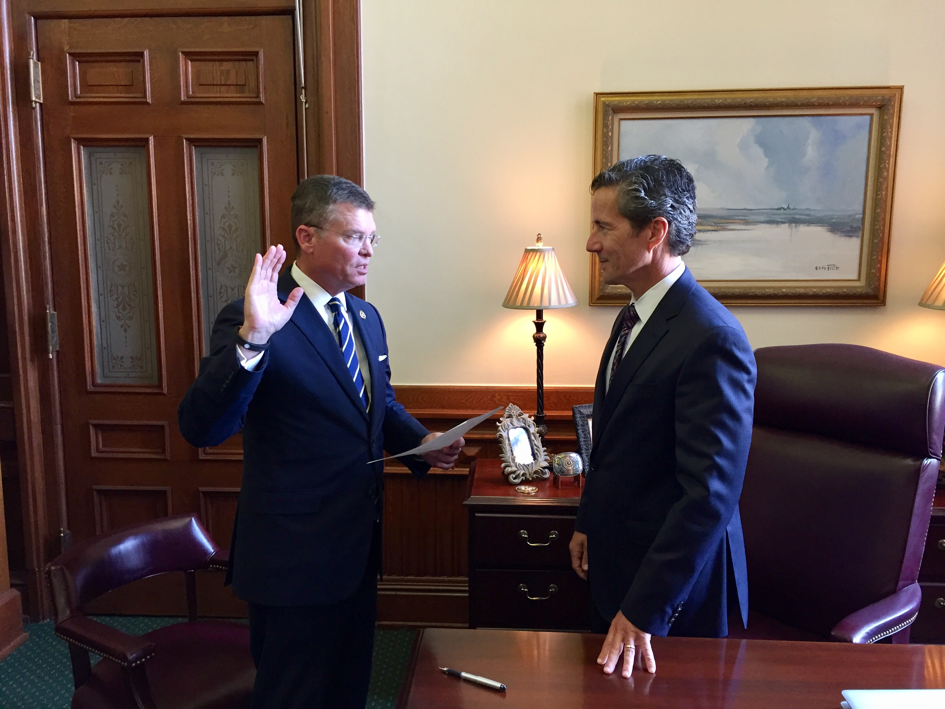 Serving Texas in several ways, Kevin Lilly is sworn in as the Texas Alcoholic Beverage Commission Chairman by State Senator Kelly Hancock, Senate District 9, at the State Capitol, Austin, Texas, May 15, 2017.  Lilly is also a lieutenant colonel in the Texas State Guard and commands the 8th Regiment.  (Courtesy Photo/The Texas Senate)