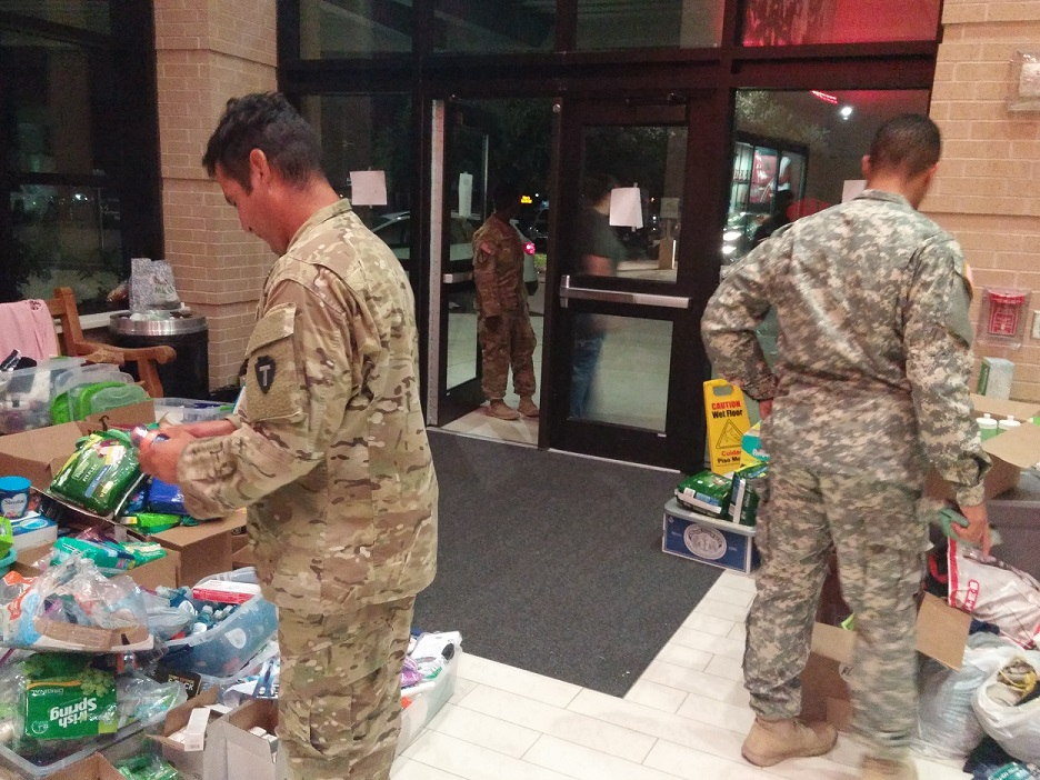 Texas National Guard and Texas State Guard Service Members pick up shampoo, soap, and other sundries donated to them by the people of Katy, Texas.  Residents of Katy wanted to show their appreciation to the guardsmen who were being deployed to assist the thousands of Texans impacted by Hurricane Harvey.  (Texas State Guard photo by Staff Sgt. Greg Illich)
