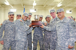 The 1st Regiment Army Component Texas State Guard team won the Gonzales Cup during the competition held in Stephenville, Texas, October 12-14, 2018.  Brig. Gen. Robert Hastings, Commander, Army Component, presented the Gonzales Cup to the team.  1st Regiment team members are Spc. Jorge Ramirez, Pvt. Alberto Sanchez, Pvt. Jason Perez, Pfc. Kevin Stepherson, Pvt. Ruben Garza, Pfc. Emilio Trevino, and Spc. Ruben Lopez. (Texas State Guard photo by Chief Warrant Officer 3 Janet Schmelzer)