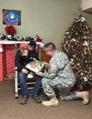 Child getting a gift from a soldier