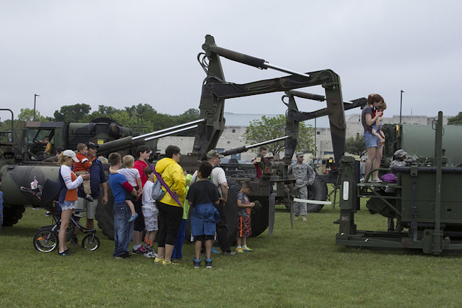 families with military equipment
